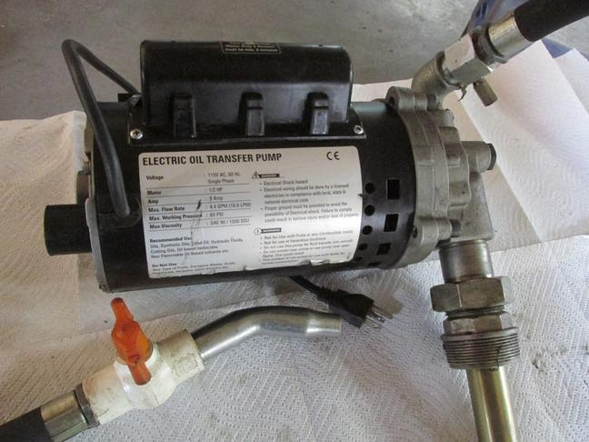 like new fast pump with suction pipe & discharge hoses / 110 volt cord